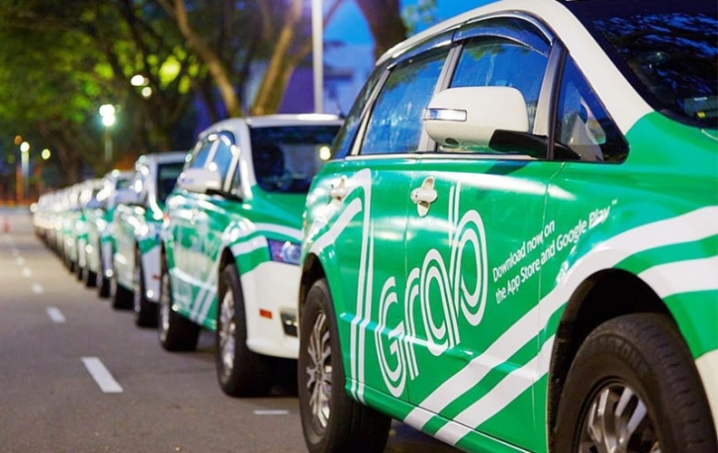 Grab and Uber as taxi firms: a step back in the Industry 4.0 era?